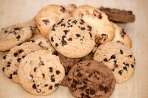 Pile of chocolate chip cookies on wooden desk
